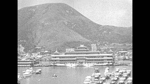 Aberdeen Fishing Village in Hong Kong, a picturesque Harbour with seafood markets, Sampan boat tours and floating restaurants. Historic restored footage on 1980.