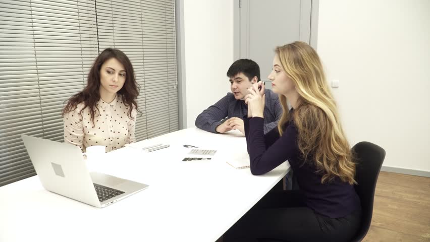Young office workers meeting in conference room | Shutterstock HD Video #25441514