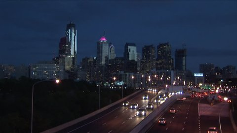 Wide shot of the Philadelphia skyline illuminated at night