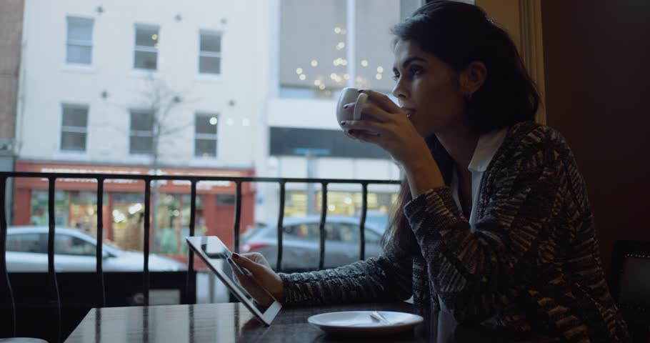 Beautiful young girl drinking coffe in the cafe. Slow motion. 4k | Shutterstock HD Video #25453754