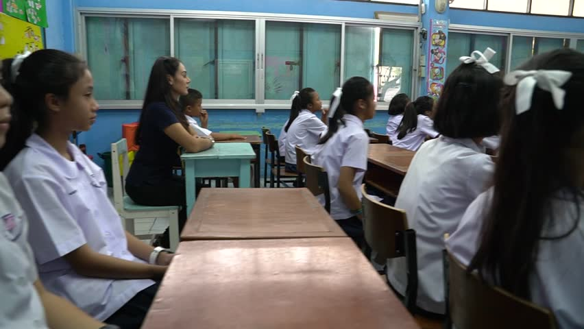 SAMUTPRAKARN, THAILAND - MARCH 24, 2017 : Thailand teacher are teaching students with fun and happiness, teacher and student in uniform