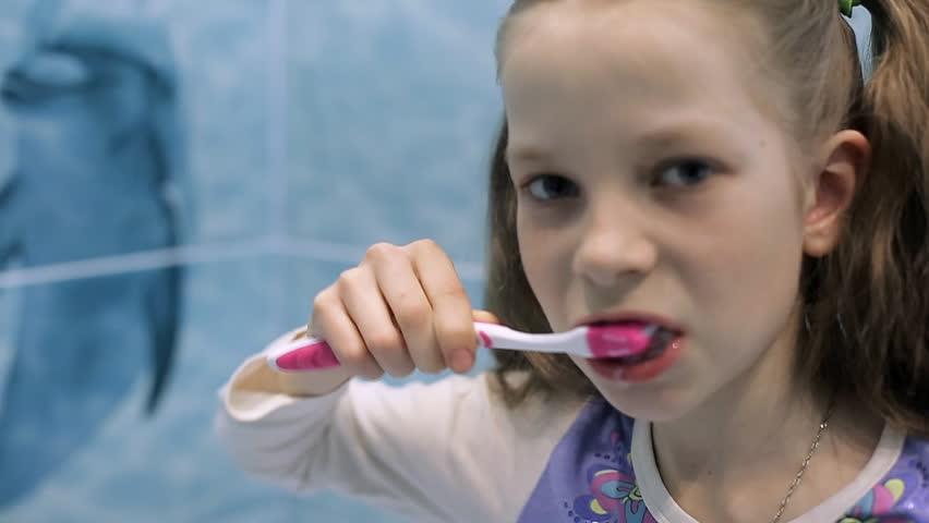 Smiling little girl brushing teeth in bath | Shutterstock HD Video #25507664