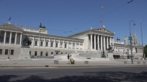 VIENNA - AUSTRIA, JULY 16, 2014, 4K Busy traffic street in downtown, Austrian Parliament building iconic
