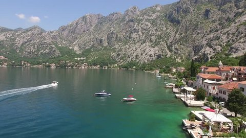 Boat in the Bay of Kotor. Montenegro, the water of the Adriatic Sea. Aerial Photo drone.
