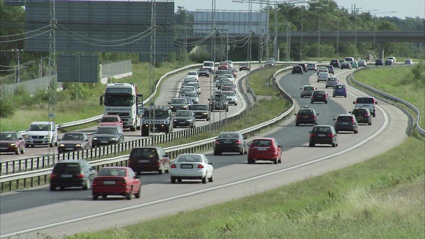 STOCKHOLM, SWEDEN - SEPTEMBER 2008: Cars driving on motorway, Stockholm, Sweden. | Shutterstock HD Video #2559374