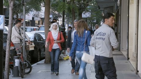 HAMRA STREET, BEIRUT - NOV 2015: Pedestrians walk on the sidewalk. Hamra Street is one of the main economic and diplomatic hubs of Beirut.