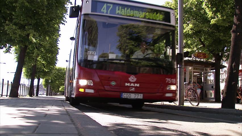 STOCKHOLM, SWEDEN - NOVEMBER 2009: A bus arriving at Strandvagen Boulevard in Stockholm, Sweden.