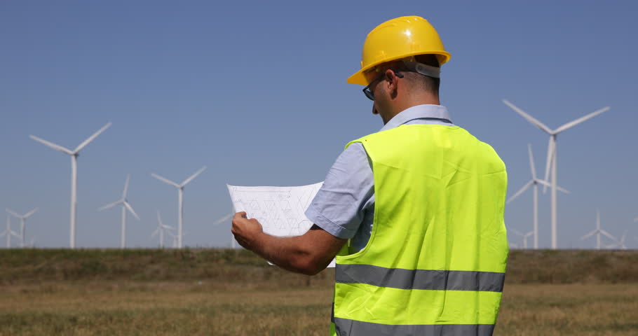 Wind turbine field power farm engineer talking man discuss people engineer man reading blueprint look out planning future wind turbines farm site 4k stock video malvernweather Gallery