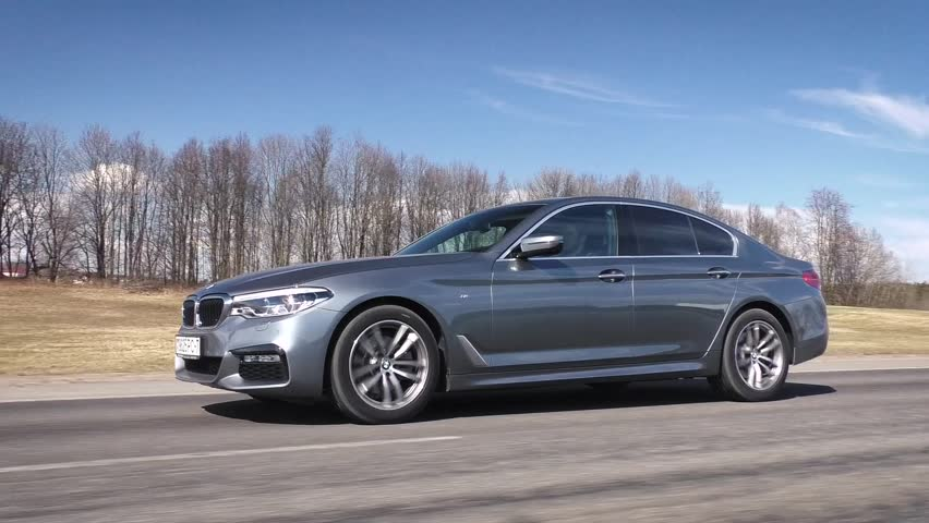 MINSK, BELARUS - APRIL 2, 2017: 2017 BMW 520d (G30) on the road. BMW 5 Series is dynamic and enjoyable to drive. In its seventh generation 5 Series is still created as an ultimate driving machine.