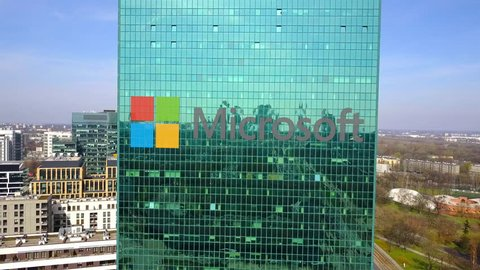 Aerial shot of office skyscraper with Microsoft logo. Modern office building. Editorial 3D rendering 4K clip