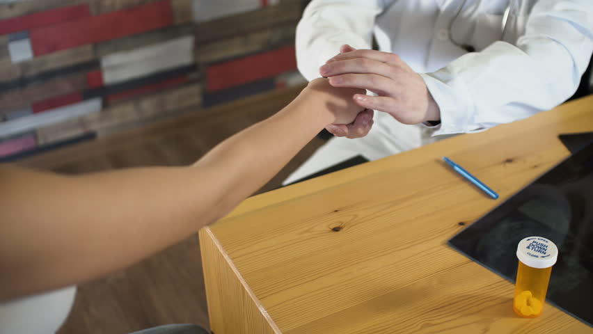 Close up of shaking hands of doctor and patient at medical room office on wooden table 4k | Shutterstock HD Video #25714514