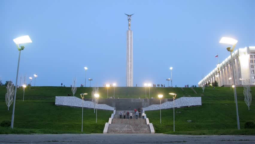 SAMARA - MAY 6: (Timelapse View) Tourists walk near Glory Monument on Glory Square in Samara in evening, on May 6, 2012 in Samara, Russia