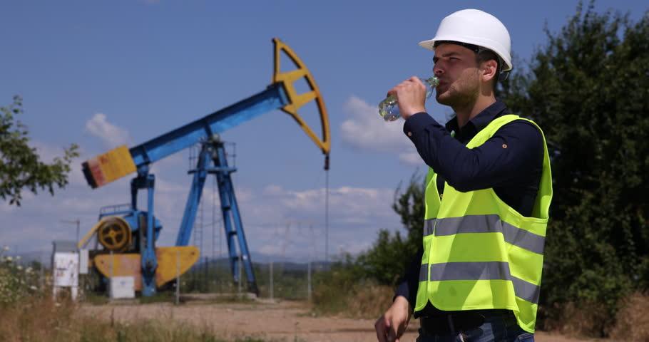 Thirsty Worker Man Drinking Water Petroleum Installations Field Hot Summer Day | Shutterstock HD Video #25727084