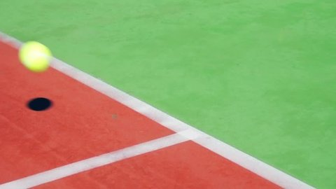 tennis ball bouncing on the line scoring point slow motion