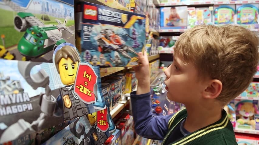 CHERNIHIV, UKRAINE - 01 APRIL 2017: 10 years old child chooses LEGO construction toys in shop.