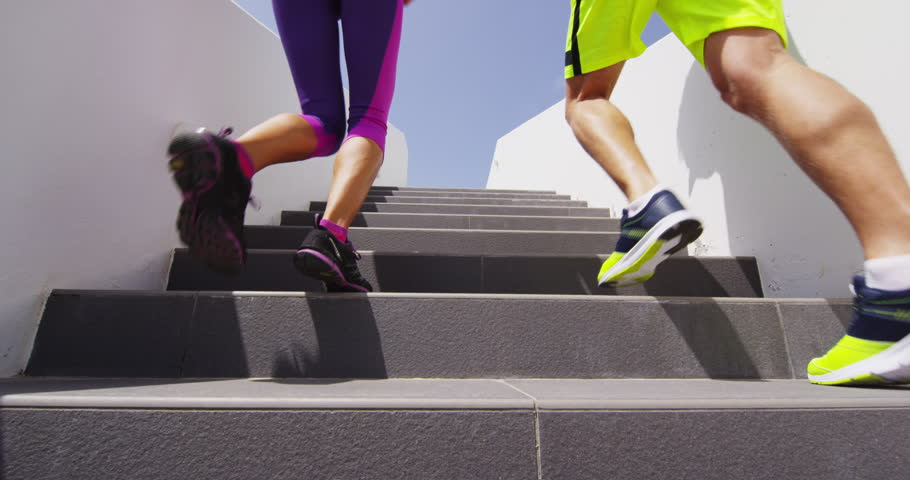 Running on stairs. Woman and man doing run up on staircase. Couple of runner athletes climbing stairs in sport workout run outside. RED EPIC SLOW MOTION. | Shutterstock HD Video #25799954