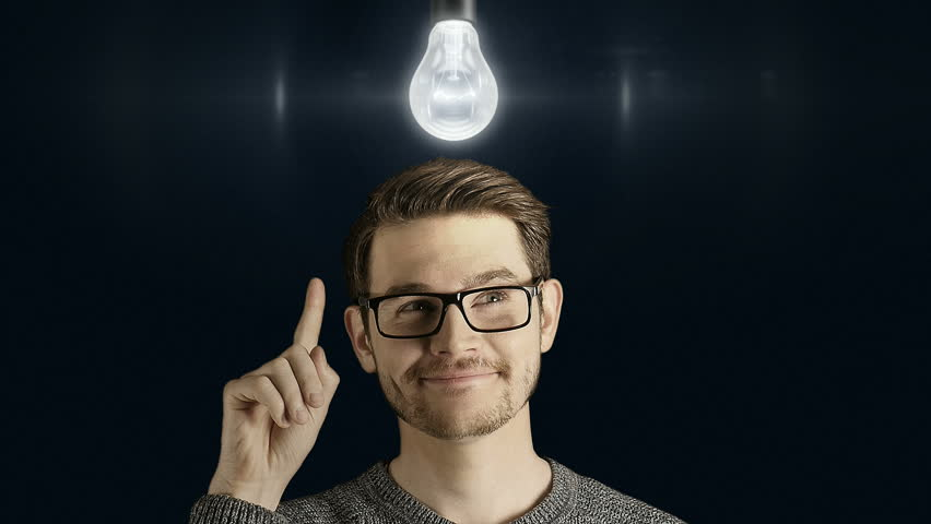 Clever creative man think gets an idea, which lights up a symbolic lamp over his head on dark background | Shutterstock HD Video #25810934