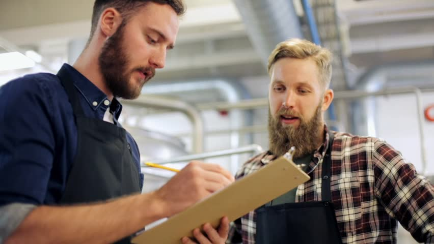 Manufacture, business and people concept - men with clipboard working at brewery or beer plant | Shutterstock HD Video #25825094