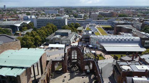 View from the spire of Coventry's old cathedral. The old cathedral ruins, the entrance of the new cathedral and Coventry University campus