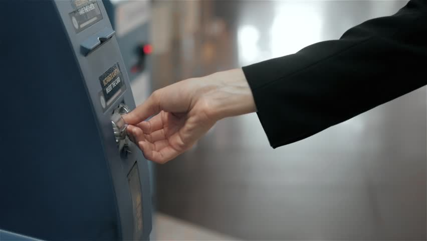 young woman inserting a credit card to ATM, beautiful girl banking, business woman after work in bank, shopping mall
