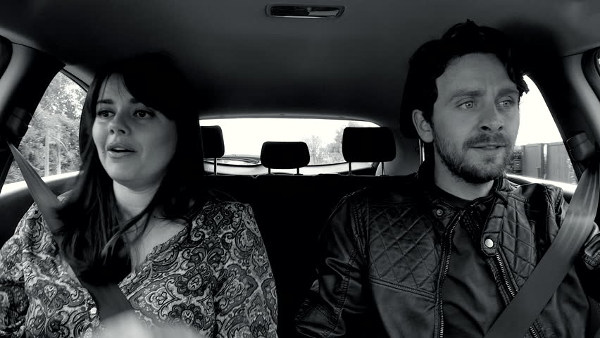 Man and woman fighting strong in car while driving black and white #25893164