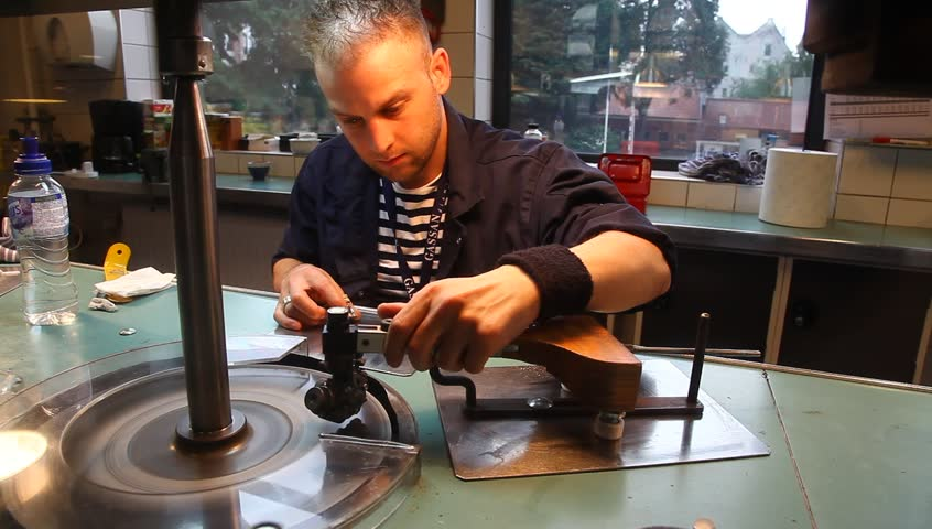 AMSTERDAM, THE NETHERLANDS - JULY 15: Diamond polisher creates a diamond with 121 facets at the Gassan Diamond factory in Amsterdam, The Netherlands, July 15, 2012