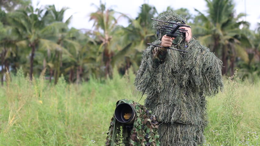 camouflage an ornithologist in the ghillie suit using radio telemetry tracking to find  bird