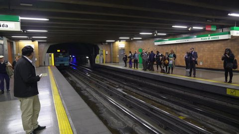 Passengers waiting for subway arriving at station Plaza de Armas in Santiago, Chile okt 5th, 2016