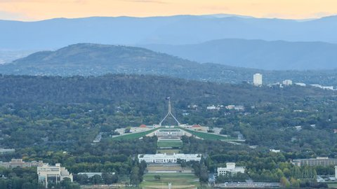 4K Day to Night timelapse zoom out motion video cityscape of Canberra, Australia.