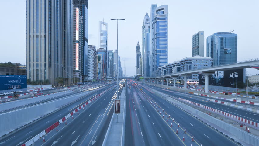 DUBAI, UNITED ARAB EMIRATES - CIRCA MAY 2011: Sheikh Zayed Rd, traffic and new high rise buildings along Dubai's main road