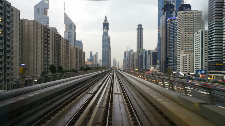 DUBAI, UNITED ARAB EMIRATES - CIRCA MAY 2011: journey on the modern Rail Metro System, running alongside the Sheikh Zayed Rd.