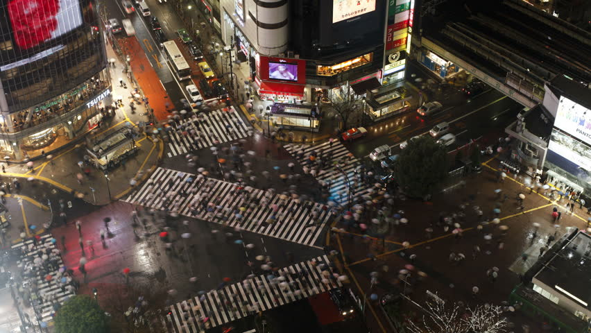 TOKYO, JAPAN - CIRCA MAY 2011: - crowds of people crossing the famous crosswalks at the centre of Shibuya's fashionable shopping and entertainment district