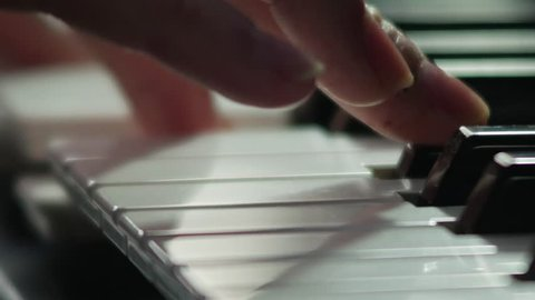 Pianist macro close up fingers playing 2160p 4K UHD 23.976 fps stock video