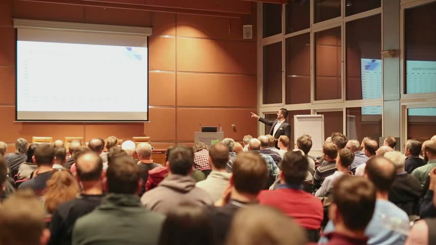 Speaker giving a talk on corporate business event. Audience at the conference hall. Business and Entrepreneurship event. | Shutterstock HD Video #25982390
