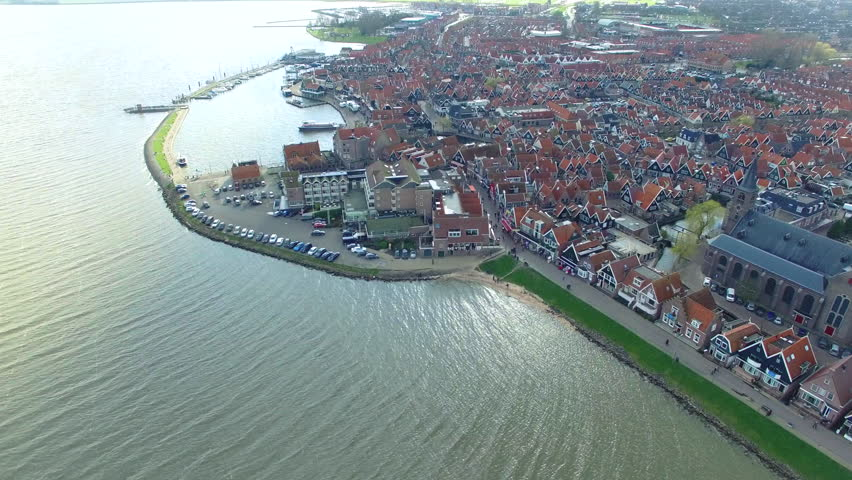 Volendam town in North Holland Ariel View Flying Towards Shore