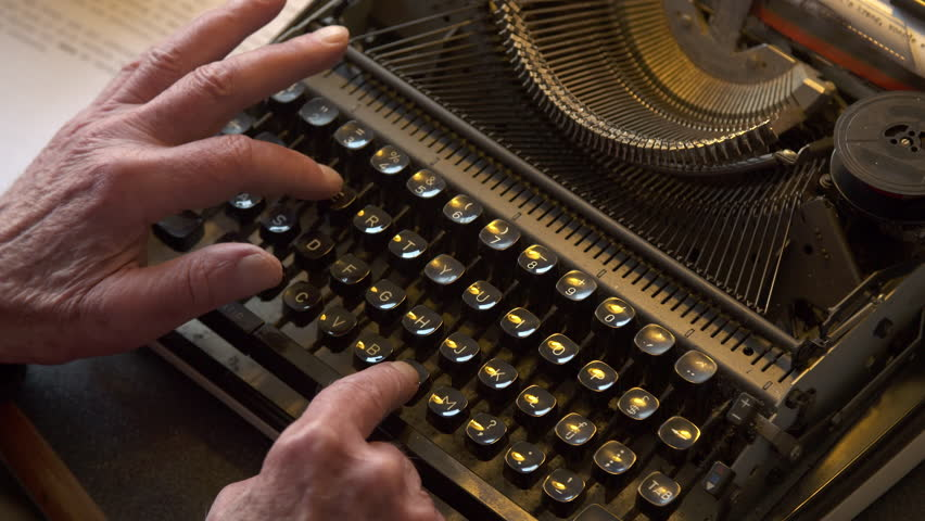 Old male hands typing on typewriter, top shot. | Shutterstock HD Video #25993364