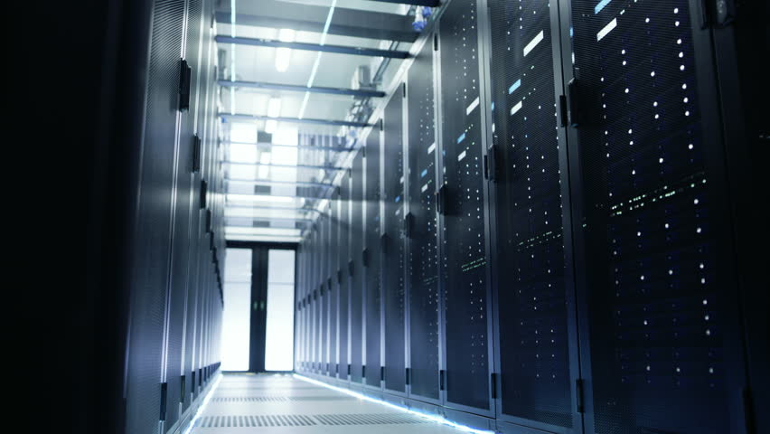 Camera Moves Through Big Working Data Center with Server Racks and Glass Ceiling. Shot on RED EPIC-W 8K Helium Cinema Camera. | Shutterstock HD Video #26008658