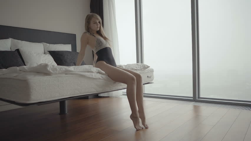 Sensual woman in lingerie showing long legs sexy pose leaning | Shutterstock HD Video #26009864