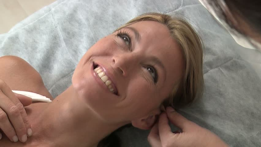 Woman in sports bra lying on operating table