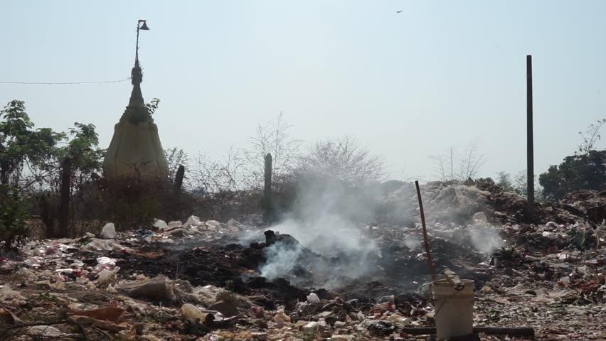 Stupa and garbage in Bago, Myanmar