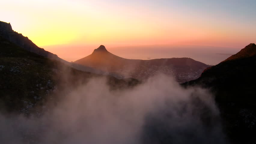 Drone reveal of Cape Town city during sunset with Lions Head and the ocean in the background. | Shutterstock HD Video #26023409