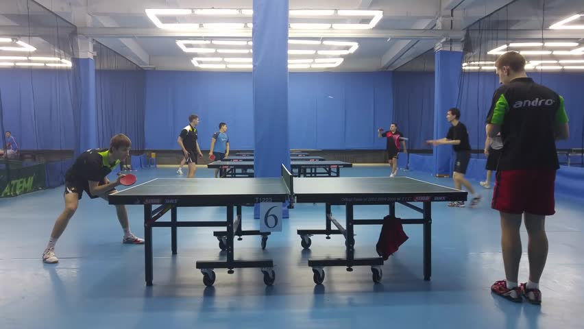 MOSCOW - JAN, 10, 2016: Couples of men playing ping pong in sports hall on Preobrazhenskaya, mobile phone video. In Moscow, regular table tennis tournaments are held.