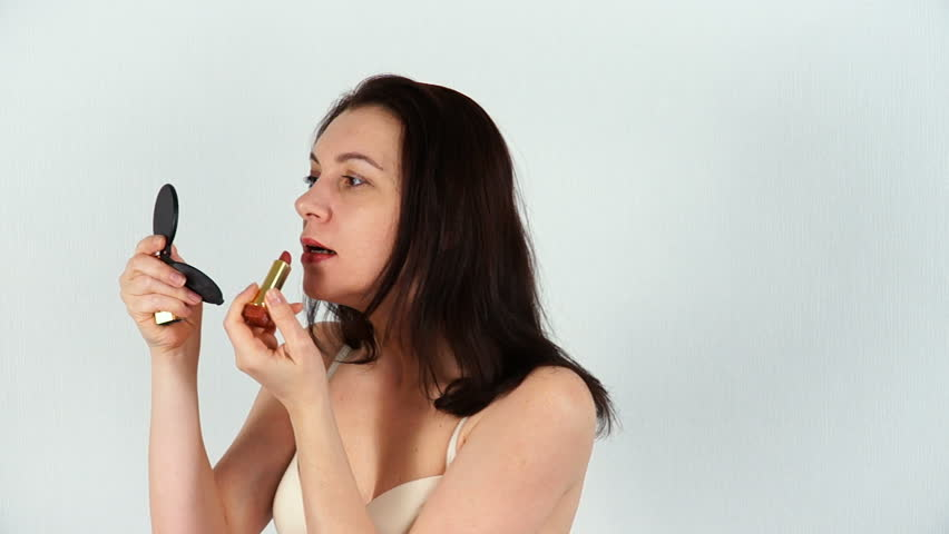 Brunette Beautiful Woman With Big Fleshy Lips Peel A Banana And Eat