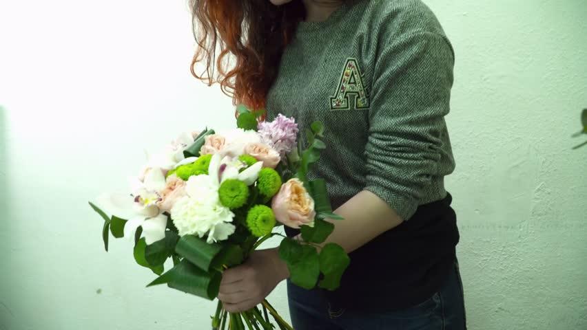 Florist woman making beautiful bouquet with orchids | Shutterstock HD Video #26092610
