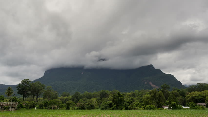 Storm clouds cover the mountain - HD stock video clip