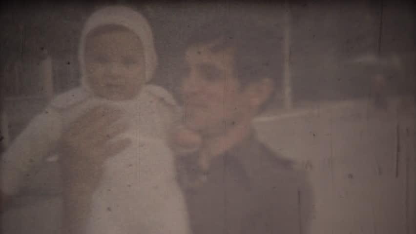 Family chronicle: Happy father shows his newborn son and feel pride. Screenshot 8 mm retro cinema camera