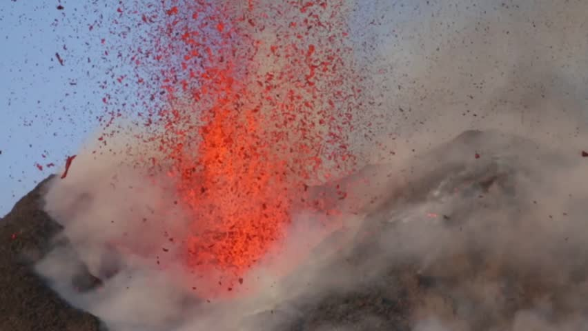 Mount Etna erupts at sunset in Sicily