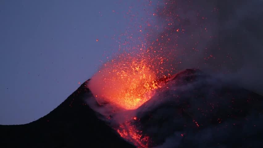 Mount Etna erupts at sunset in Sicily