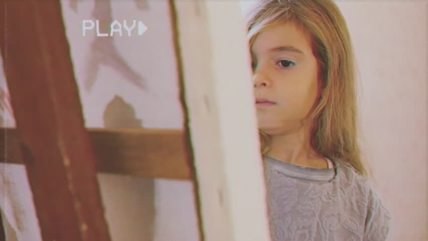 Fake VHS tape: a pretty little girl painting with acrylic colors on a canvas, in a brightly lit room. Close-up shot.    Shutterstock HD Video #26202584