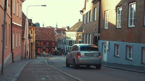 HELSINGBORG, SWEDEN - DECEMBER 12, 2016 City street view in Helsingborg town. Cars passing by